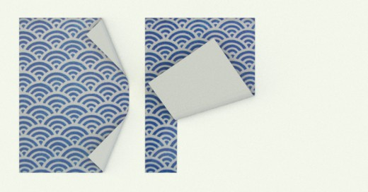 Dos papeles plegados formando las iniciales de Diseño de Producto