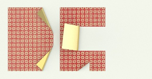 Dos papeles a medio plegar formando las letras DG