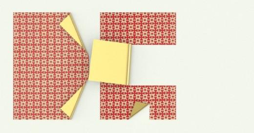 Dos papeles plegados formando las letras DG